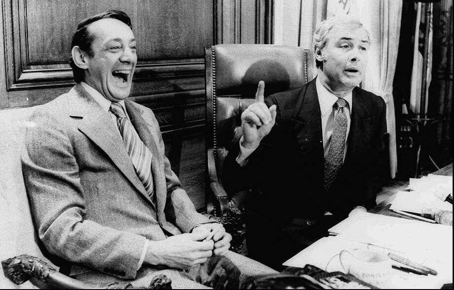 San Francisco Supervisor Harvey Milk (left) and Mayor George Moscone are shown in April 1977 in the mayor's office during the signing of the city's gay rights bill. Photo: Bob McLeod, SF Examiner / Bancroft Library