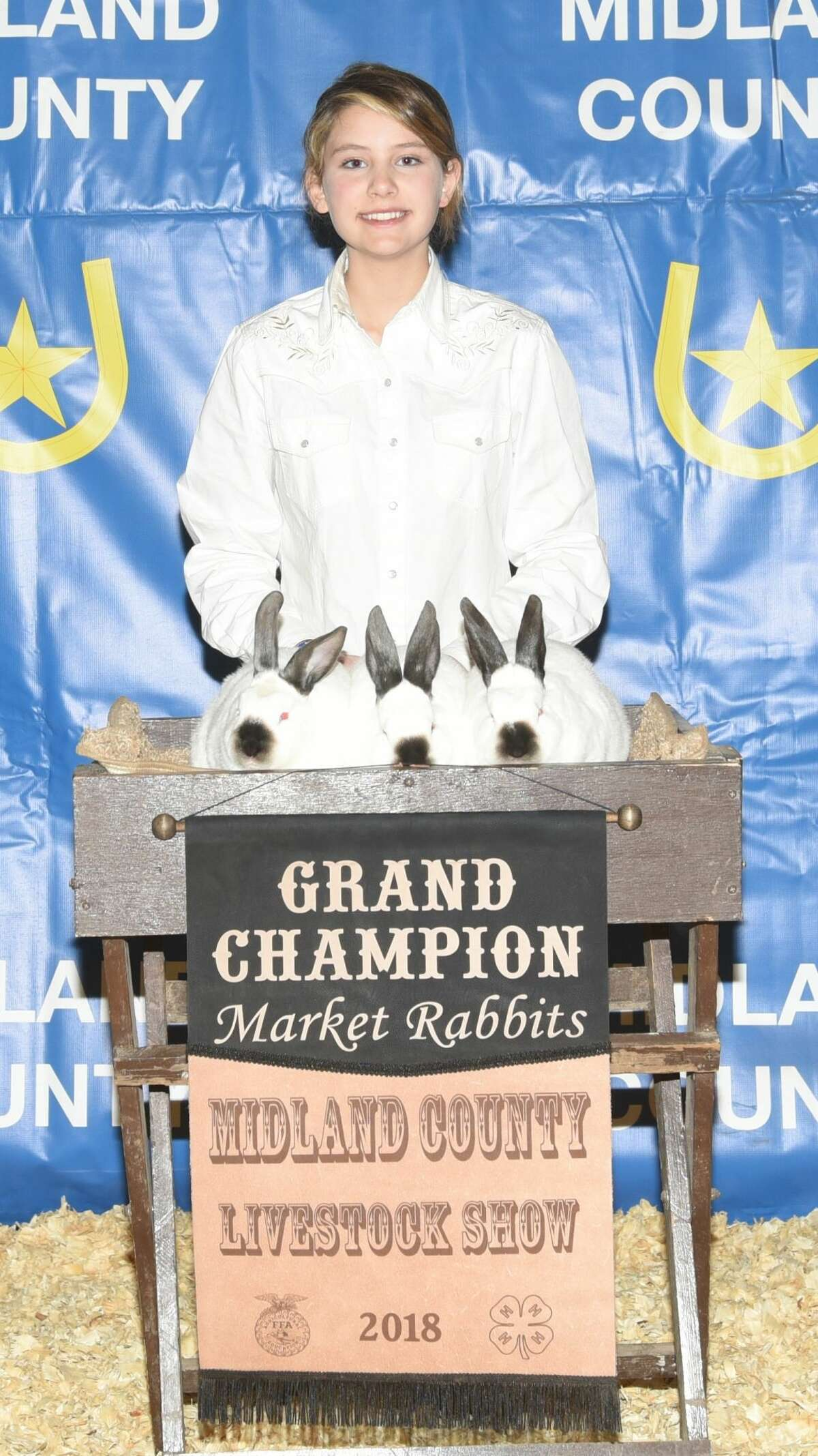 Grand Champion pen of meat rabbits shown by Sophia Jones