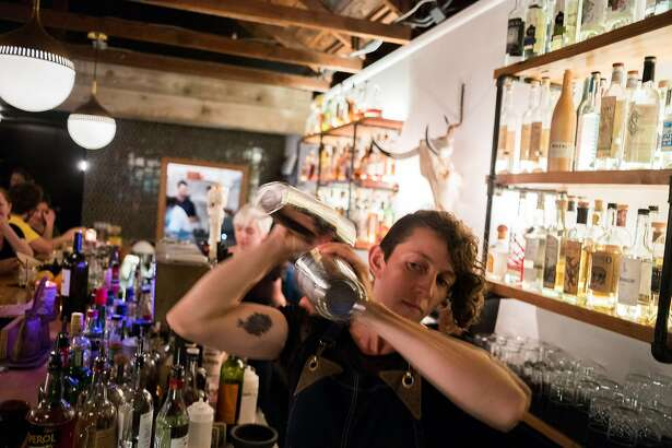 General manager Zoe Rem creates craft cocktails at El Barrio, a bar in Guerneville, CA specializing in tequila, mescal, bourbon and craft cocktails on Feb. 3, 2018.