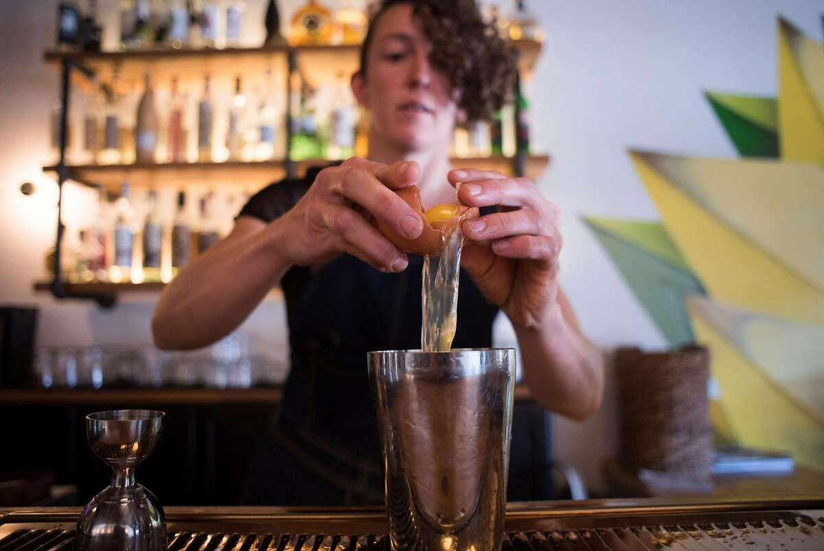 General manager Zoe Rem creates a craft cocktail at El Barrio, a bar in Guerneville, CA specializing in tequila, mescal, bourbon and craft cocktails on Feb. 3, 2018.