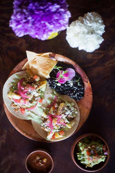 Carnitas tacos with a side of beans at El Barrio in Guerneville. Photo: Brian L. Frank, Special To The Chronicle