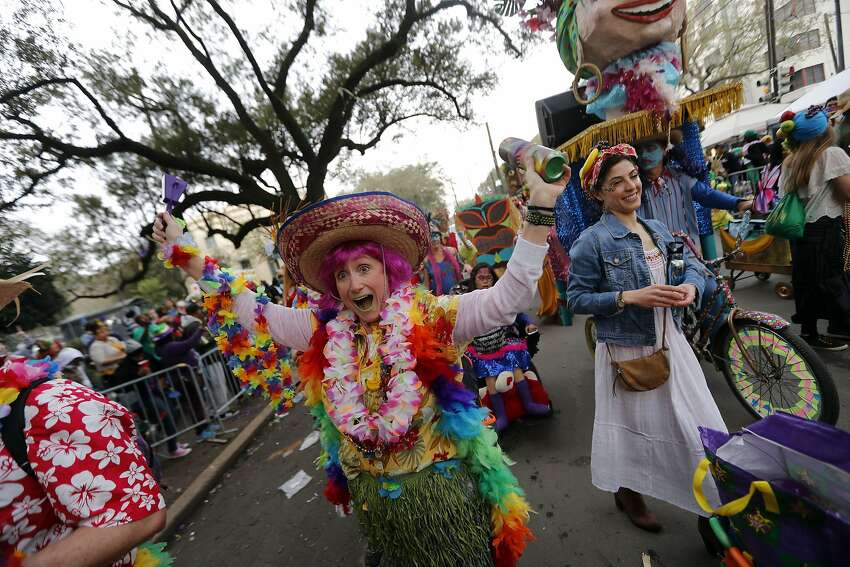 Members of the Mondo Kayo walking club march and dance down the route of the Krewe of Zulu parade in New Orleans. Mardi Gras draws about 1 million visitors to the city.
