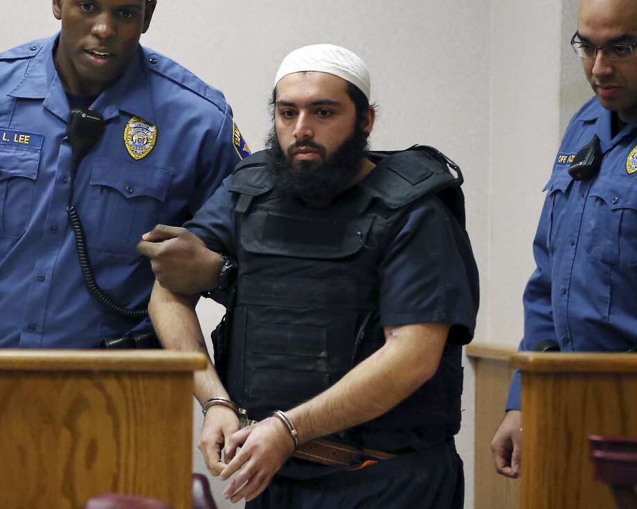 FILE - In this Dec. 20, 2016, file photo, Ahmad Khan Rahimi, center, is led into court in Elizabeth, N.J. Rahimi, who set off small bombs on a New York City street and at a charity race in New Jersey, is set to be sentenced to a mandatory term of life in prison. He is scheduled to be sentenced Tuesday, Feb. 13, 2018, by a federal judge in Manhattan. (AP Photo/Mel Evans, File) Photo: Mel Evans, Associated Press