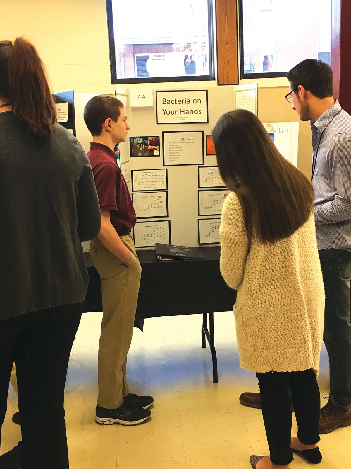 Connor Coolbaugh, also in the seventh grade, shares his projects with the judges.