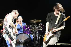 SAN FRANCISCO, CA - DECEMBER 14:  (L-R) Flea, Chad Smith, and Josh Klinghoffer of Red Hot Chili Peppers perform during Band Together 2 at Bill Graham Civic Auditorium on December 14, 2017 in San Francisco, California.  (Photo by Tim Mosenfelder/Getty Images)