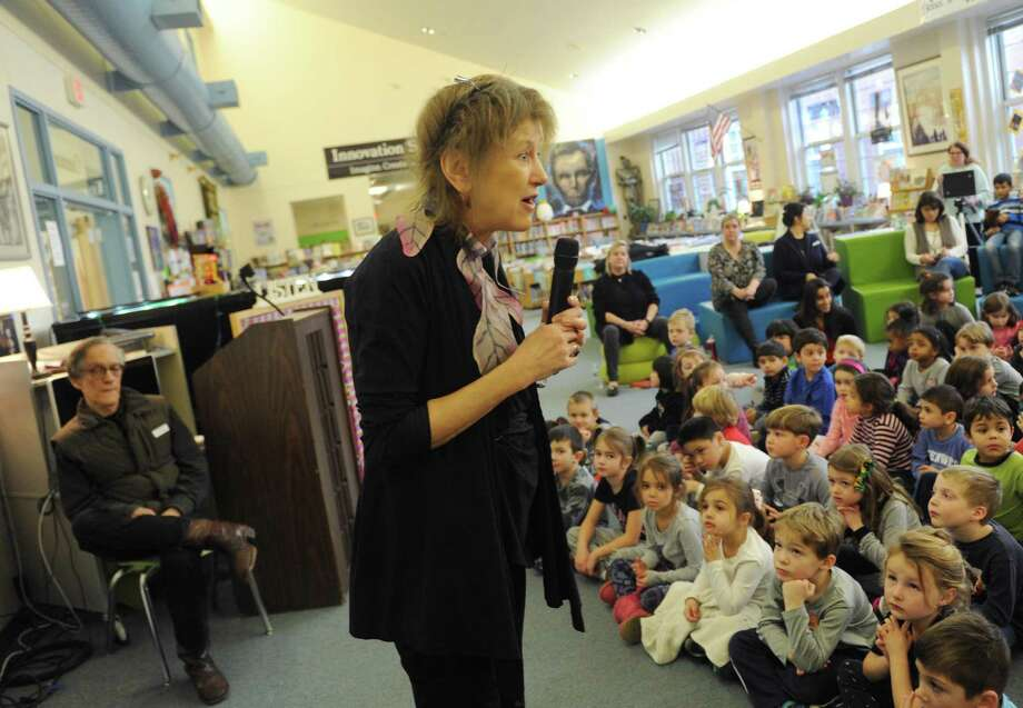 "Author Judith (J.C.) Greenburg speaks about the inspiration for her children's book as her husband Dan Greenburg, left, watches at Cos Cob School in the Cos Cob section of Greenwich, Conn. Tuesday, Jan. 23, 2018. Judith Greenburg pens the ""Andrew Lost"" series. Also speaking was her husband, Dan Greenburg, author of the ""Zack Files"" and ""Weird Planet"" series. Photo: Tyler Sizemore / Hearst Connecticut Media / Greenwich Time"