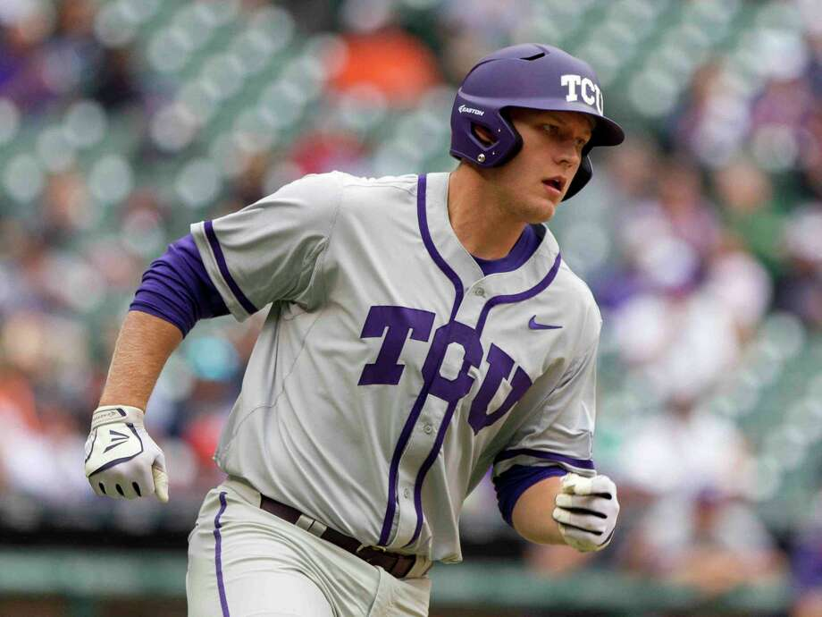 TCU's Luken Baker, former Oak Ridge player, runs to first base after hitting a single during the second inning of a NCAA baseball game against Houston at the Houston College Classic at Minute Maid Park Sunday. Feb. 28, 2016. Photo: Jason Fochtman / Internal