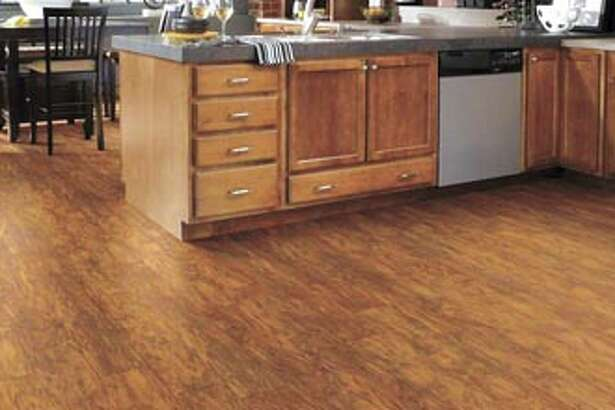Get the deep, rich aura of wood in the kitchen? Looks like it! With Floorté vinyl plank flooring from Shaw—available at Southwest Floors, 1113 Andrews Highway in Midland.