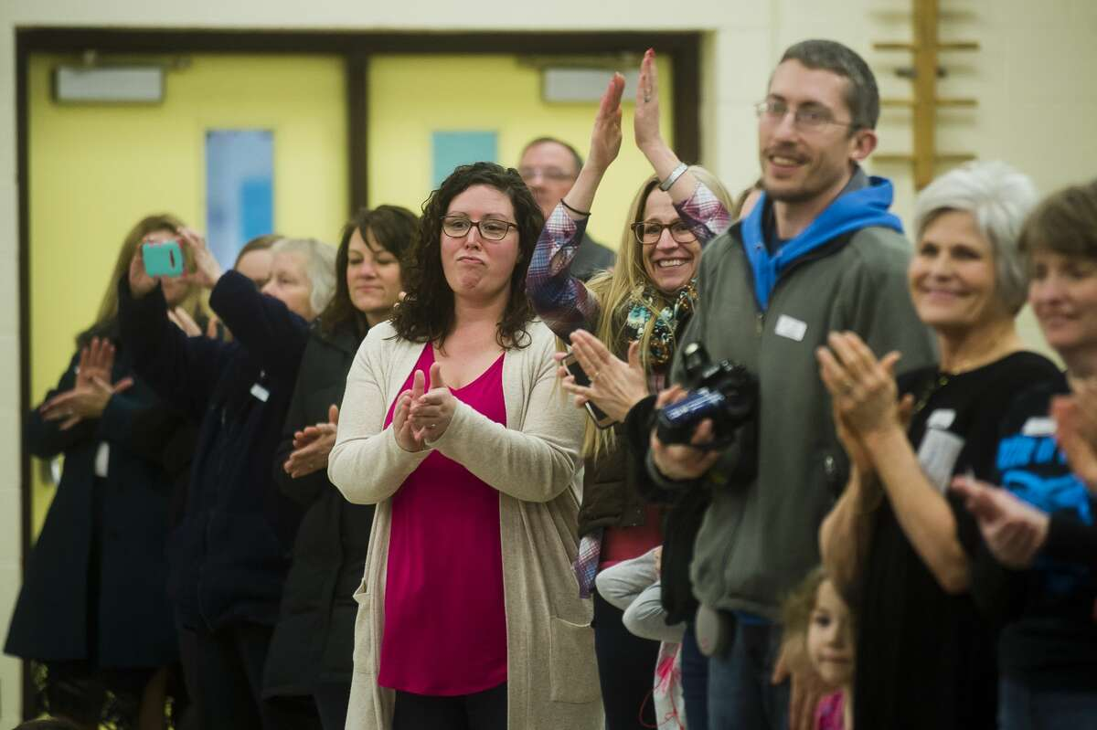 Parents and teachers applaud Officer Jeremy Davis of the Midland Police Department during a D.A.R.E. graduation at Adams Elementary, where Davis has taught D.A.R.E. for the past nine years, on Tuesday, Feb. 13, 2018. Davis is now a part of the department?•s detective bureau. (Katy Kildee/kkildee@mdn.net)