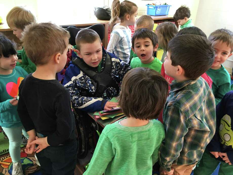 Sam Buck, a student at the Glenville School, is the center of attention at a recent art show and fundraiser at the Greenwich Christian Preschool. Photo: / Contributed