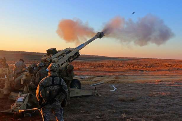 Airborne Artillerymen assigned to 3rd Battalion, 319th Airborne Field Artillery Regiment, 82nd Airborne Division Artillery conduct live fire missions as the sun rises over Sicily Drop Zone, on Fort Bragg, N.C. on Feb. 8, 2016 after their M77A2 155MM medium howitzer was air dropped in the dark of night from a C-17 aircraft.
