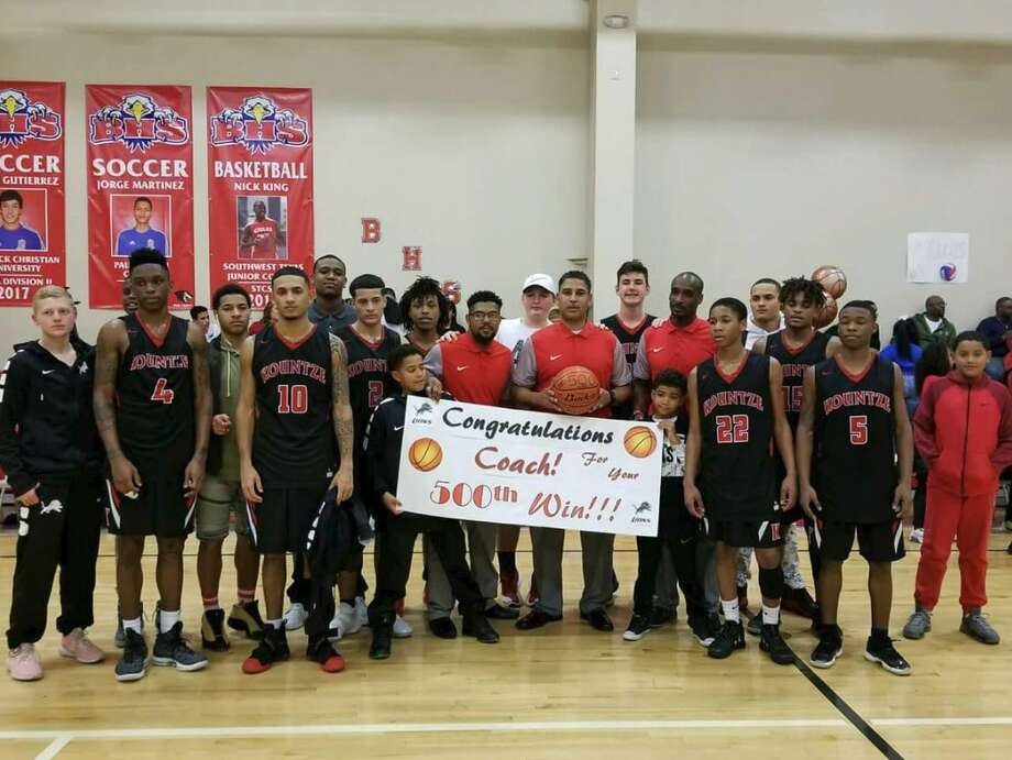 Kountze boys basketball coach Duane Joubert is presented with a basketball after achieving his 500th win as a head coach on Feb. 9. (Photo: @KountzeABC)