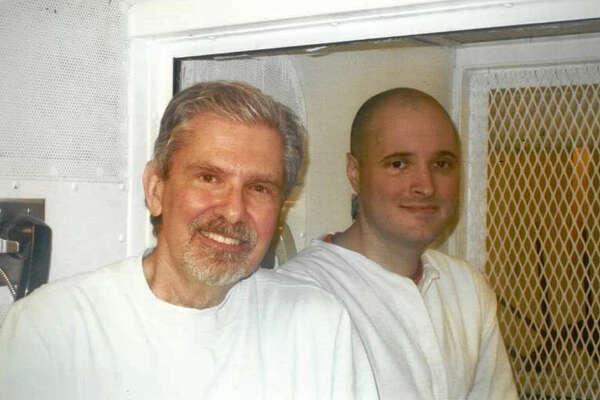 """File photo taken October 2016 shows Kent Whitaker (L) and his son Bart during a visit to Bart's prison in Polunsky, Texas. Bart Whitaker is scheduled for execution on February 22, 2018 for setting up the ambush that killed his mother and brother in 2003. Kent, his father, survived the shooting and, after learning to forgive his son, is asking state officials for mercy.   / AFP PHOTO / FAMILY HANDOUT / TO GO WITH AFP STORY by Sebastien Blanc """"Texan fights for life of son who had family members killed"""" --- RESTRICTED TO EDITORIAL USE - MANDATORY CREDIT """"AFP PHOTO / FAMILY HANDOUT"""" - NO MARKETING - NO ADVERTISING CAMPAIGNS - DISTRIBUTED AS A SERVICE TO CLIENTS - NO ARCHIVES / FAMILY HANDOUT/AFP/Getty Images"""