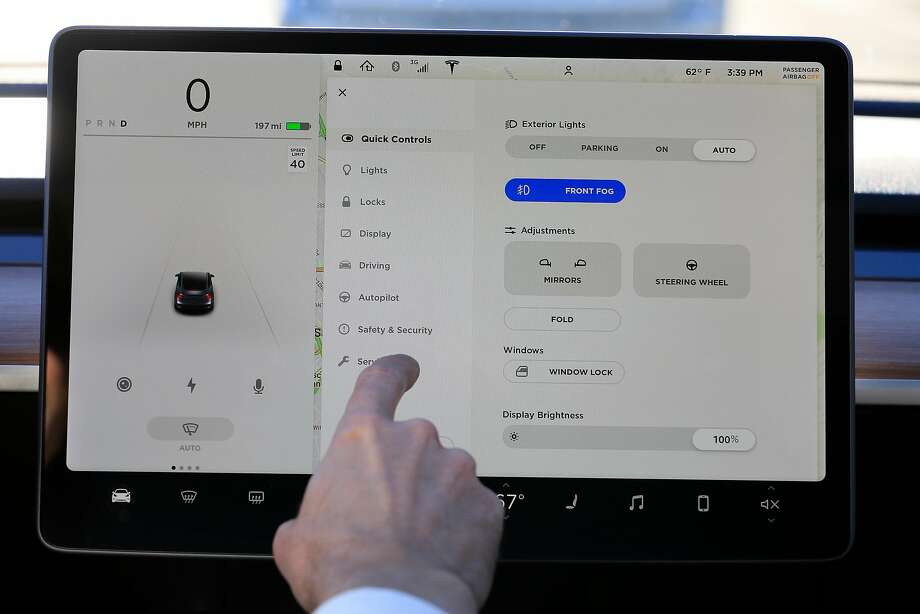 Instead of a dashboard, a 15-inch touch-screen to the right of the steering wheel displays the Tesla Model 3's vehicle info and controls. Photo: Lea Suzuki, The Chronicle