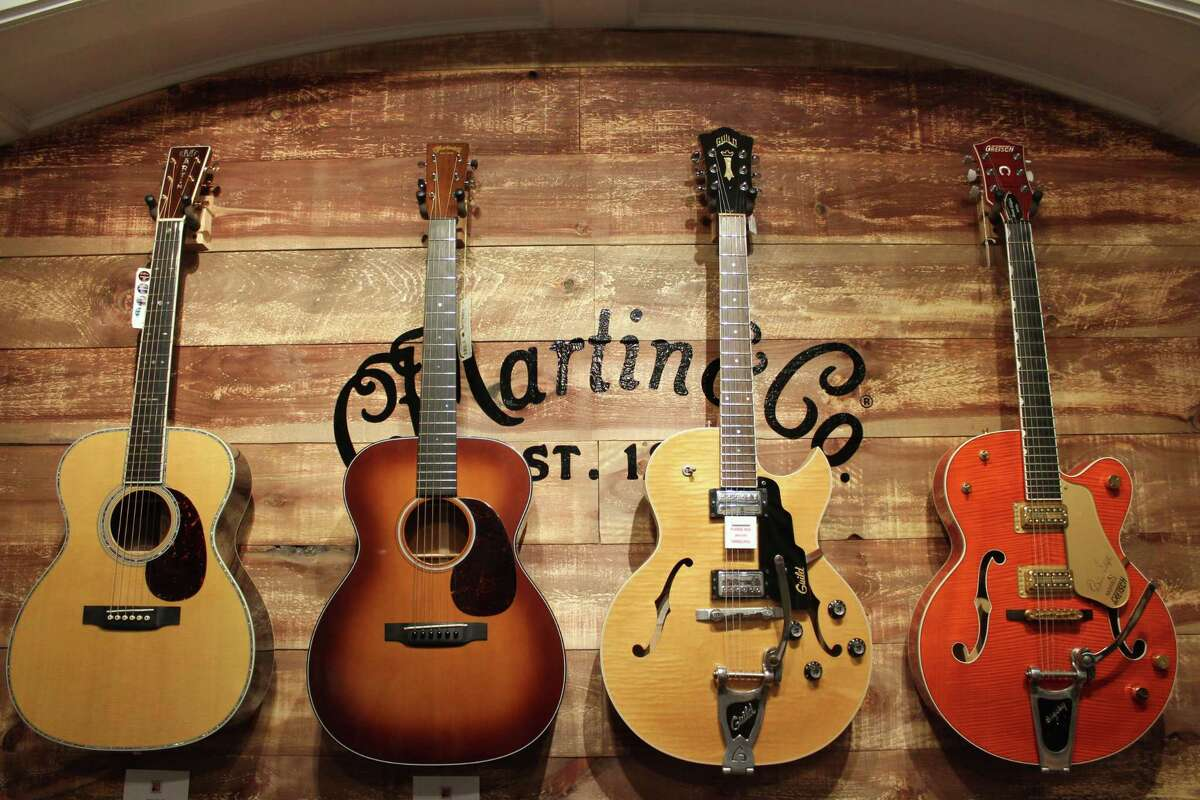 New Canaan Music and its collection of guitars from C. F. Martin & Company on Monday.