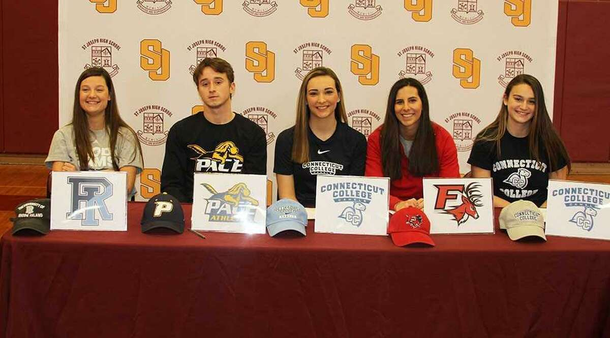 St. Joseph High School hosted an athletic Signing Day ceremony at the Trumbull school on Tuesday. Five senior students signed either National Letters of Intent or Commitment Letters for their prospective colleges. The following students signed, from left: Tory Bike, soccer, Rhode Island, Division I, National Letter of Intent; Mike DiIorio, football, Pace, Division II, National Letter of Intent; Bridget Fatse, volleyball, Connecticut College, Division III, Commitment Letter; Alexis Mason, soccer, Fairfield, Division I, Commitment Letter; and Veronica O'Rourke, soccer, Connecticut College, Division III, Commitment Letter.