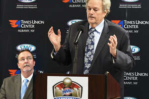 MAAC commissioner Rich Ensor, right, has a longtime business relationship with Times Union Center general manager Bob Belber, left. (John Carl D'Annibale/Times Union)