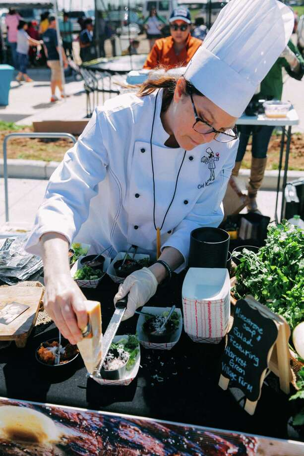 Private Chef Kerri Allee puts the finishing touches on her culinary creation at last year's Chef Fest in Harvest Green. Photo: Courtesy Photo