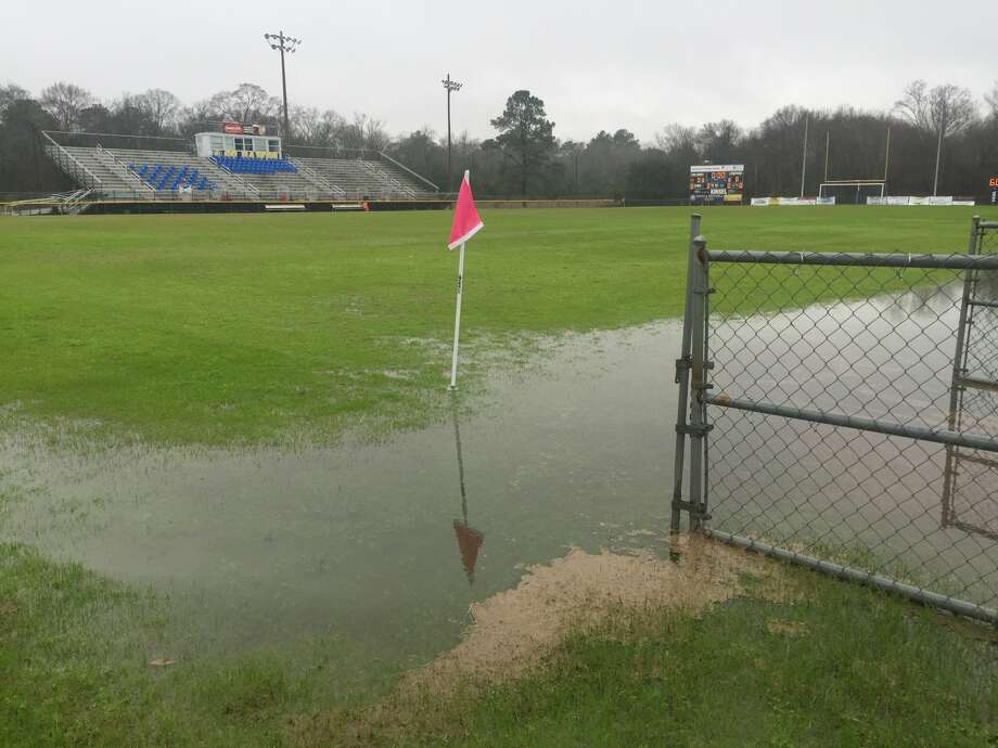 Rainwater covers parts of the field at Kelly High School's Bulldog Stadium on Tuesday, Feb. 13, 2018. (Photo by Matt Faye/The Enterprise)
