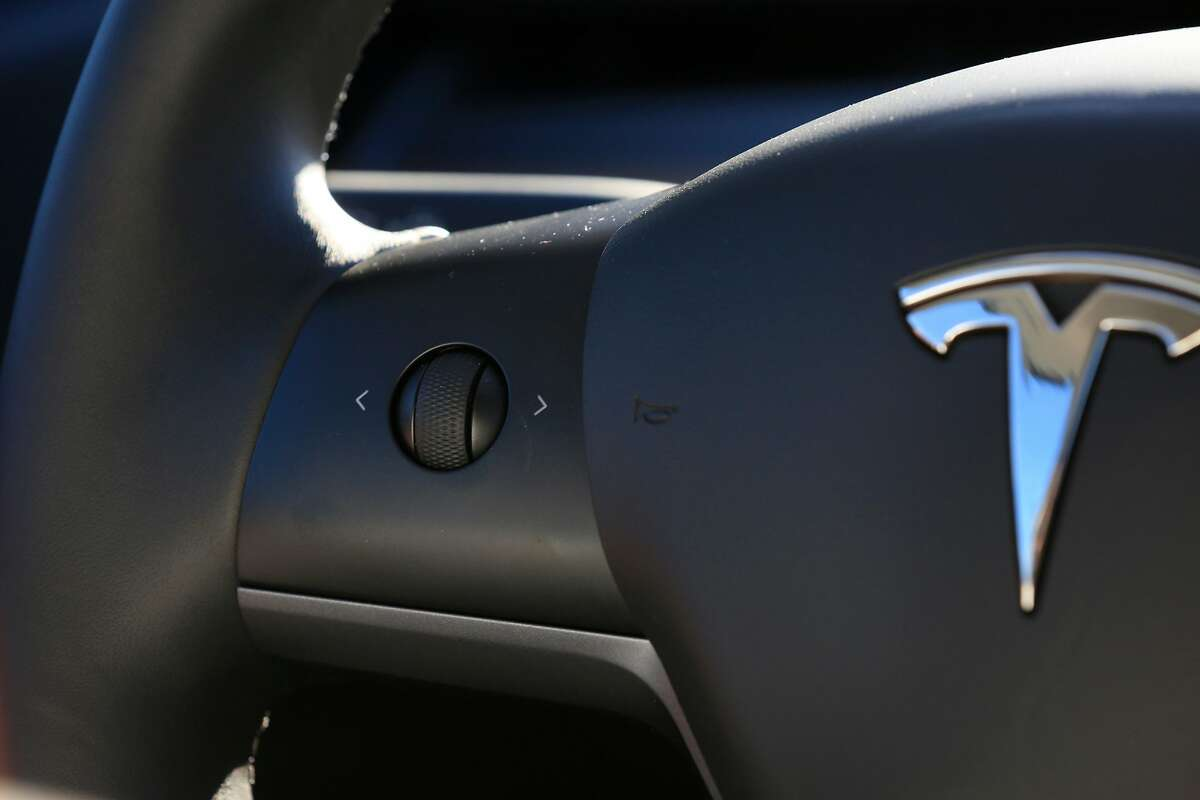 A control button is seen on the steering wheel of a Tesla Model 3 in Fremont, Calif., on Monday, February�12, 2018.