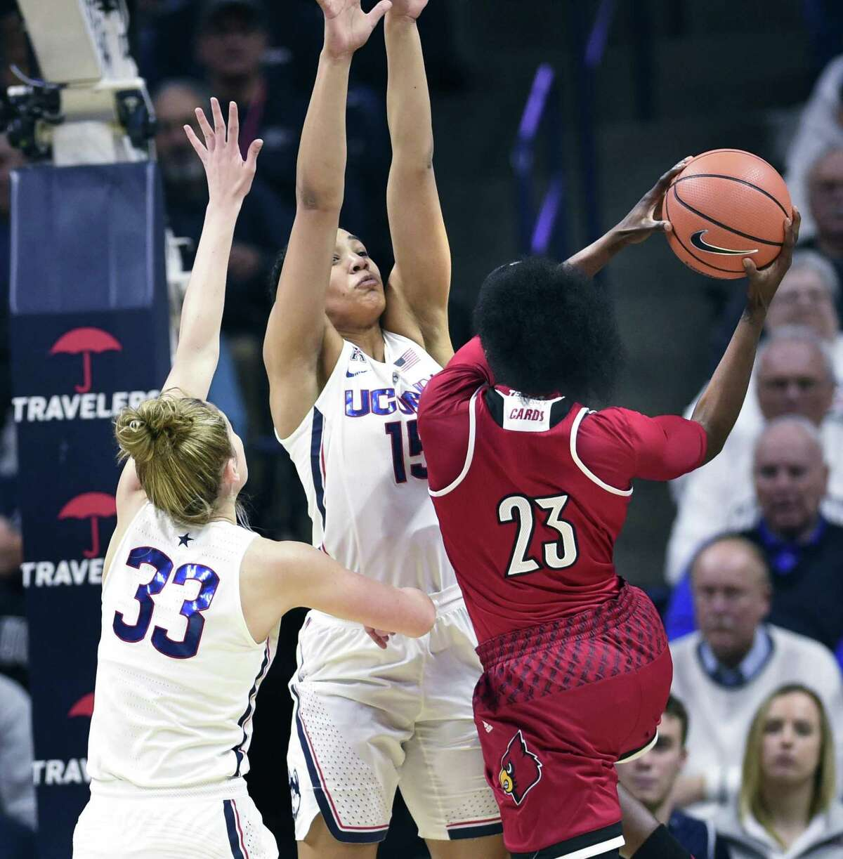 Louisville's Jazmine Jones (23) is defended by Connecticut's Gabby Williams (15) and Connecticut's Katie Lou Samuelson (33) in the second half of an NCAA college basketball game Monday, Feb. 12, 2018, in Storrs, Conn. UConn won 69-58. (AP Photo/Stephen Dunn)