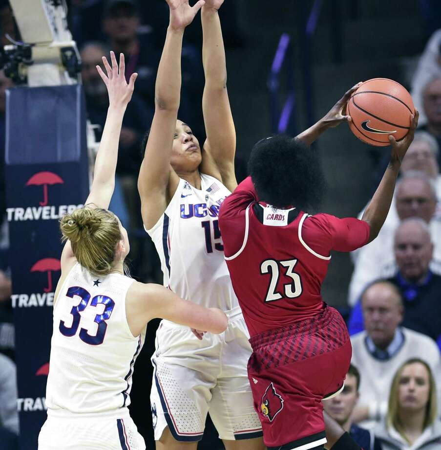 Louisville's Jazmine Jones (23) is defended by Connecticut's Gabby Williams (15) and Connecticut's Katie Lou Samuelson (33) in the second half of an NCAA college basketball game Monday, Feb. 12, 2018, in Storrs, Conn. UConn won 69-58. (AP Photo/Stephen Dunn) Photo: Stephen Dunn / Associated Press / FR171426 AP