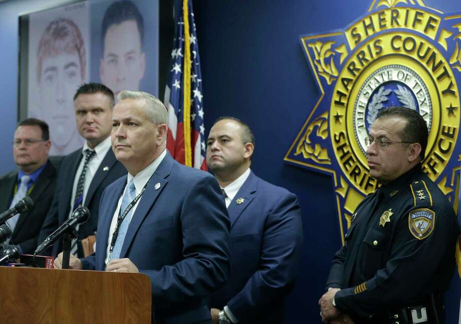 Harris County Sheriff's Office Lt. Jerry Philpot, center, with Sgt. Russell Gonzales, second from right, and Chief Deputy Edison Toquica, right, speaks during a media conference at the Harris County Sheriff's Office,1200 Baker, Tuesday, Feb. 13, 2018, in Houston. They released details regarding the arrest of Levi Austin Goss, 24, an Army soldier stationed at Fort Bragg, who was charged in the 2013 kidnapping and rape of a 16-year-old girl in Cypress. Photo: Melissa Phillip, Houston Chronicle / © 2018 Houston Chronicle