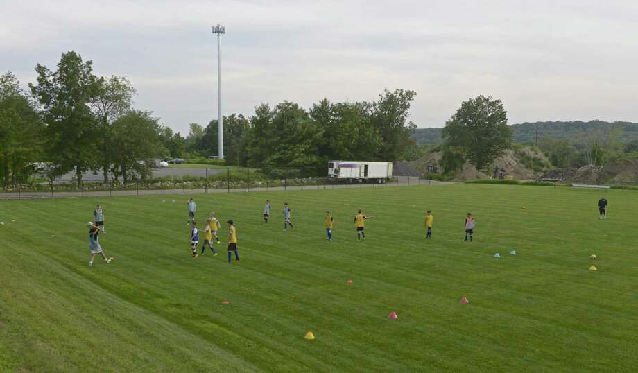A Brookfield Soccer Club summer camp on Horse Field, at the Brookfield Municipal Center. The field is the proposed location for the new Brookfield Library building. Thursday, August 10, 2017, in Brookfield, Conn. Photo: H John Voorhees III / Hearst Connecticut Media / The News-Times