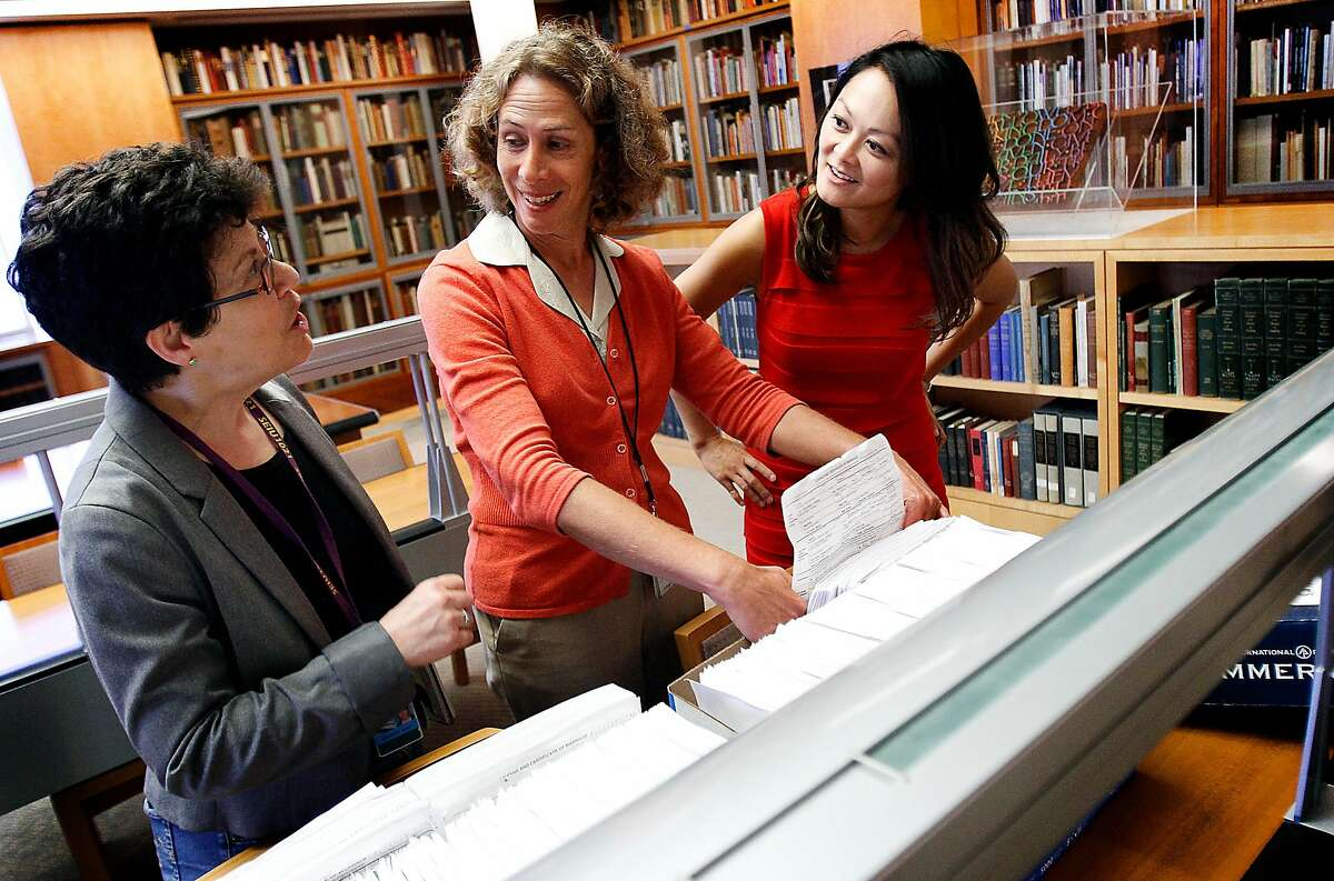 San Francisco recorder-assessor Carmen Chu, right, city archivist Susan Goldstein, center, and Karen Sundheim, the director of the Gay and Lesbian Center at the San Francisco Public Library, take a look at the same-sex marriage certificates from 2004 that Chu brought to donate to the city archives at the San Francisco public library in San Francisco, Calif., Wednesday, August 28, 2013. The certificates, which were deemed invalid by the courts, helped kick off the process that culminated in gay marriage being deemed legal in California earlier this year, and are now a part of the city's archives.