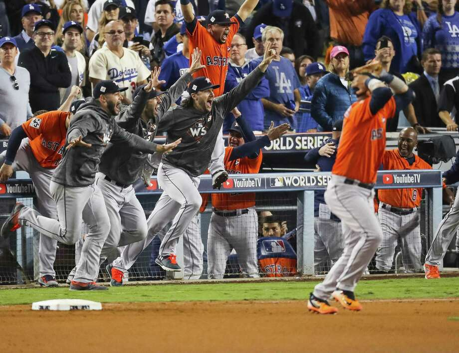 A jubilant Astros dugout poured onto the field after Houston's Game 7 World Series victory at Dodger Stadium on Nov. 1. Photo: Michael Ciaglo / Houston Chronicle / © 2017 Houston Chronicle