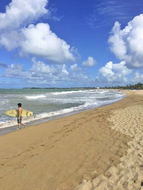 A photo by Paola Singer of Isla Verde beach in San Juan, Puerto Rico. After Hurricane Maria, parts of the Puerto Rican capital are back in business. Tourism is down but the scene can be lively. (Paola Singer via The New York Times) NO SALES; FOR EDITORIAL USE ONLY WITH NYT STORY SLUGGED PUERTO RICO REBOUND  BY SINGER FOR FEB. 6, 2018. ALL OTHER USE PROHIBITED. Photo: PAOLA SINGER, NYT