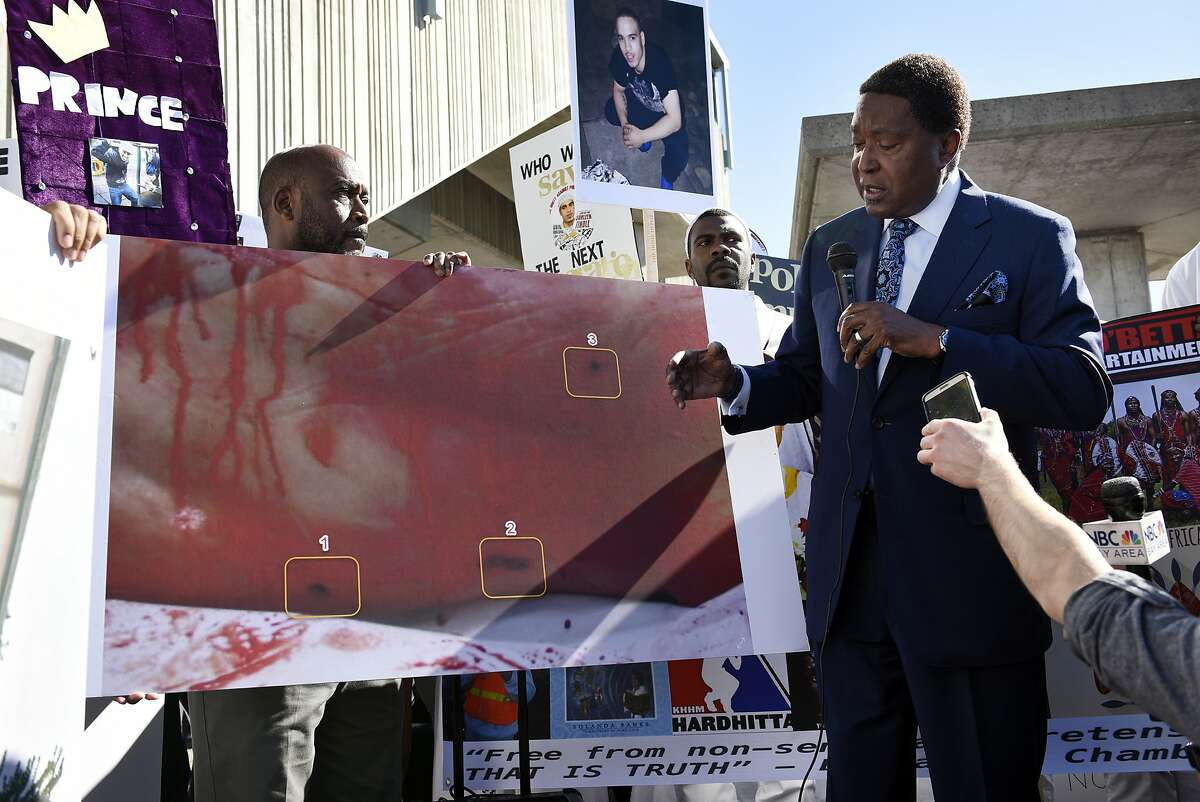 Attorney John Burris points to a picture of Sahleem Tindle's body and bullet wounds.Burris said video footage shown to the family by Oakland police proves that there was no firearm in Tindle's hands when he was shot three times in the back.