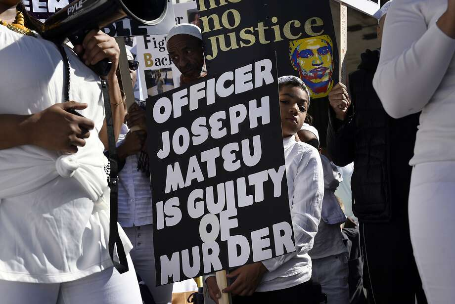 Rally attendees hold signs calling for Officer Joseph Mateu to be held accountable for the shooting ofSahleem Tindle. Photo: Michael Short, Special To The Chronicle