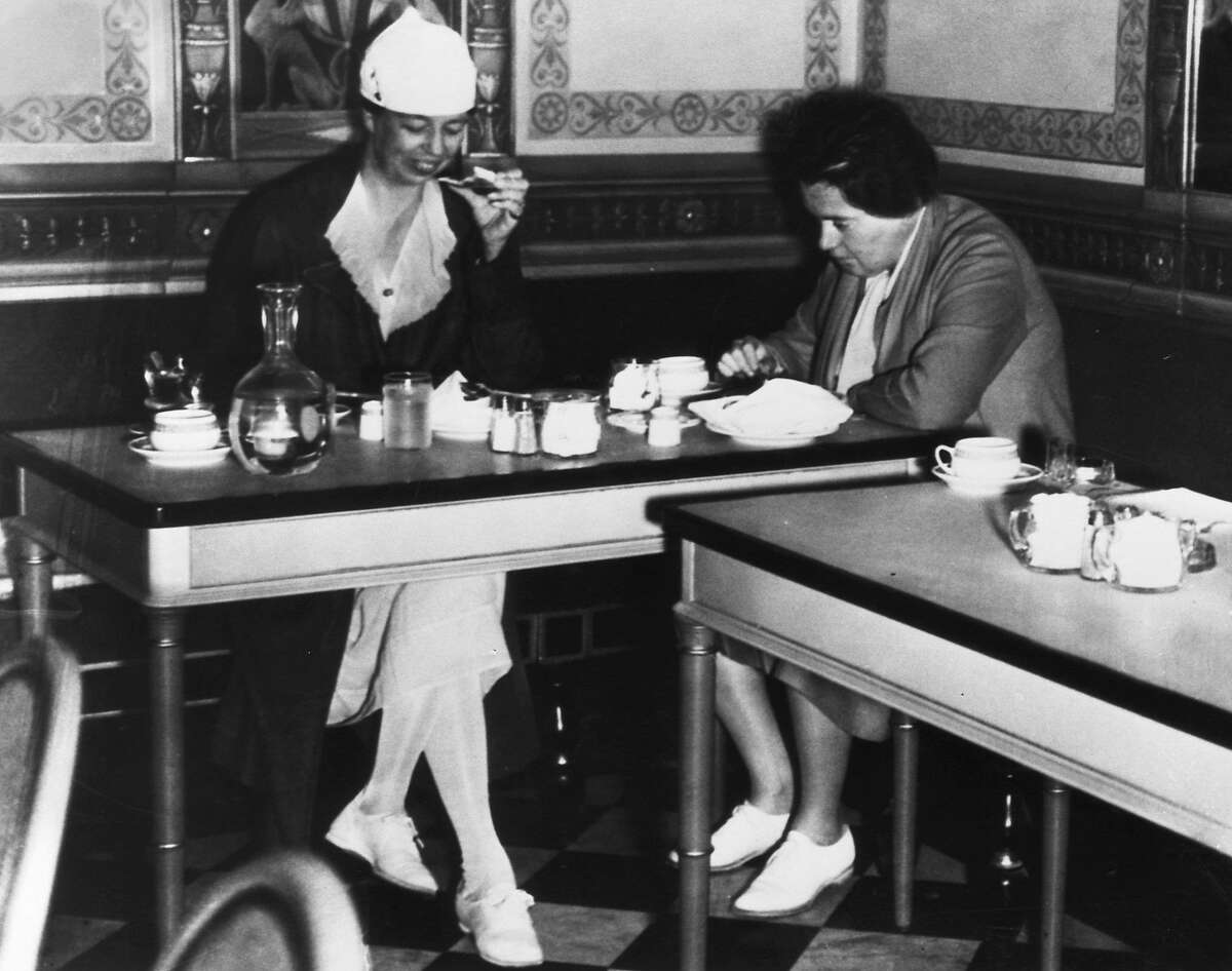 Eleanor Roosevelt and Lorena Hickok dine at a modest restaurant in San Francisco in 1934.