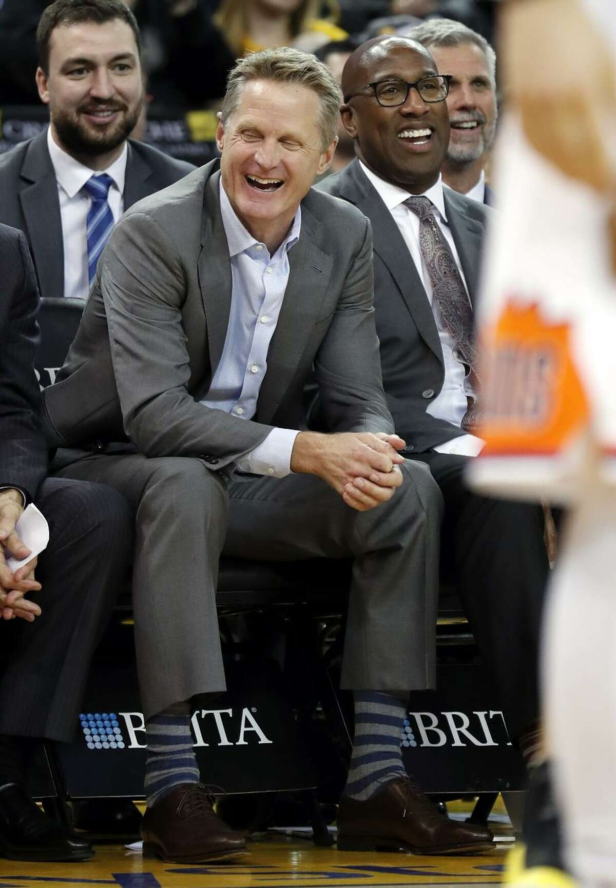 Head coach Steve Kerr and assistant Mike Brown (in glasses) took some of the night off in the Warriors' rout of Phoenix.