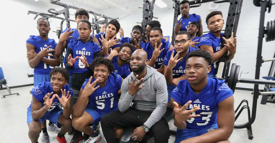 Houston Texans cornerback Johnathan Joseph and the Willowridge High School Football team pose for photos Tuesday, Feb. 13, 2018, in Houston. Joseph and UnitedHealthcare donated a new weight room equipment to Fort Bend ISD's Willowridge High School athletics. The new equipment replaces items damaged by mold discovered at WHS this summer. After extensive remediation and cleanup, students returned to WHS in January. The donation was made possible by a $10,000 grant from UnitedHealthcare to Joseph's Dreambuilders program. ( Steve Gonzales / Houston Chronicle ) Photo: Steve Gonzales/Houston Chronicle