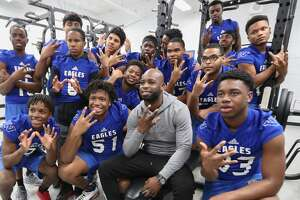 Houston Texans cornerback Johnathan Joseph and the Willowridge High School Football team pose for photos Tuesday, Feb. 13, 2018, in Houston. Joseph and UnitedHealthcare donated a new weight room equipment to Fort Bend ISD's Willowridge High School athletics. The new equipment replaces items damaged by mold discovered at WHS this summer. After extensive remediation and cleanup, students returned to WHS in January. The donation was made possible by a $10,000 grant from UnitedHealthcare to Joseph's Dreambuilders program. ( Steve Gonzales / Houston Chronicle )
