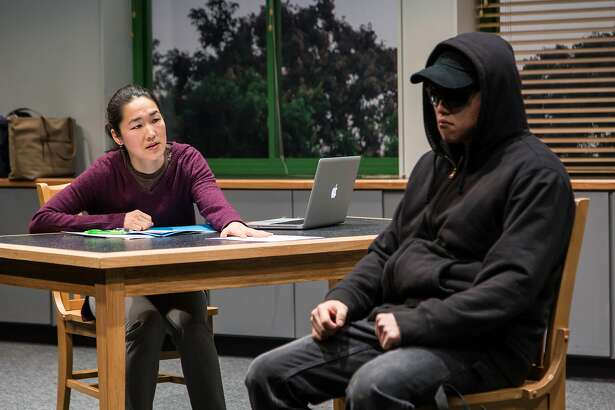 """From left: Jackie Chung as Gina and Daniel Chung as Dennis in """"Office Hour,"""" a coproduction by Berkeley Rep and Long Wharf Theatre."""