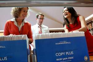 San Francisco recorder-assessor Carmen Chu, right, her communications director Eddie McCaffrey, center, and city archivist Susan Goldstein, left, take a look at the same-sex marriage certificates from 2004 that Chu brought to donate to the city archives at the San Francisco public library in San Francisco, Calif., Wednesday, August 28, 2013.  The certificates, which were deemed invalid by the courts, helped kick off the process that culminated in gay marriage being deemed legal in California earlier this year, and are now a part of the city's archives.