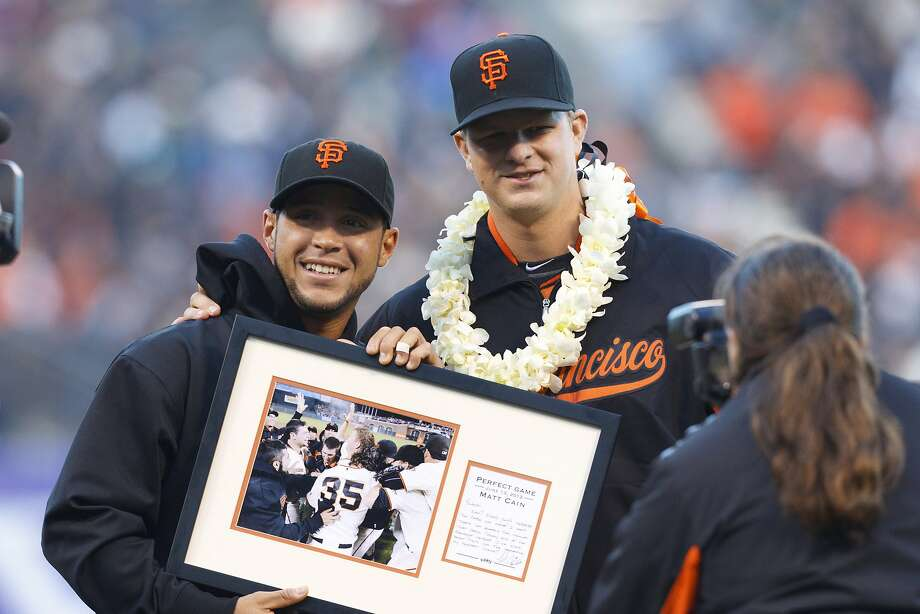 In this 2012 photo, Matt Cain presents Gregor Blanco with a photo after Cain's perfect game, which Blanco saved with a diving catch. Photo: Jason O. Watson, Getty Images