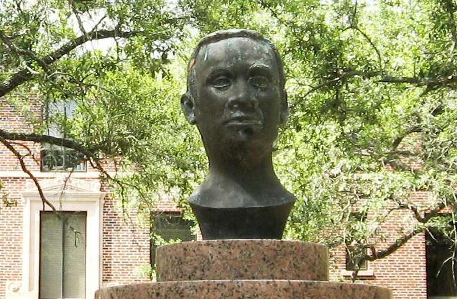 "This bust of Abner Davis stands in front of the Woolfolk Building on the campus of Prairie View A&M University. A lawsuit, filed by a student identified only as ""Mary Doe,"" accuses Prairie View A&M of creating a hostile educational environment and violating the federal Title IX law that prohibits gender discrimination in schools and universities. Photo: Prairie View A&M / handout"