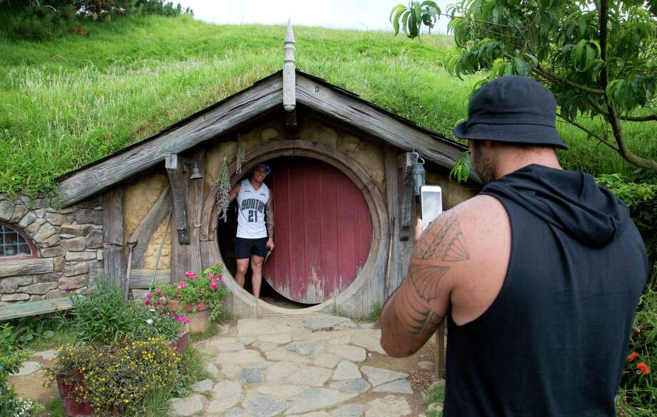 FILE - In this Dec. 31, 2015, file photo, tourists take photos during a tour of the Hobbit movie set near Matamata, New Zealand. (AP Photo/Mark Baker, File) Photo: Mark Baker / Copyright 2018 The Associated Press. All rights reserved.
