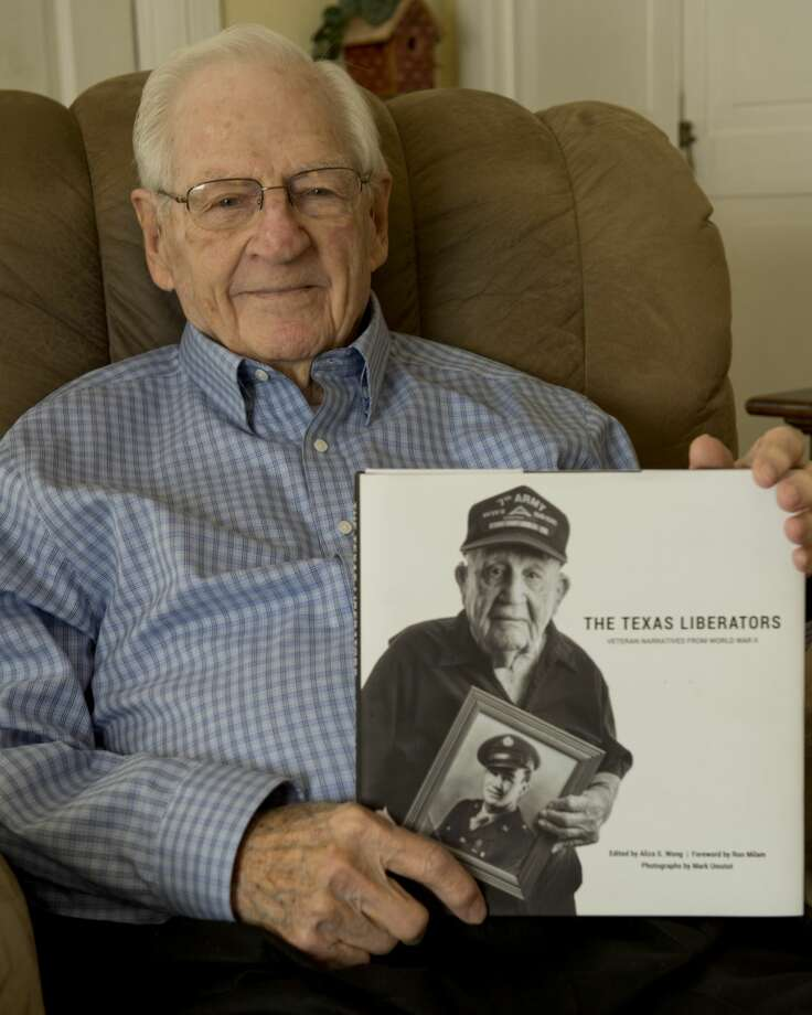 Bill Womack, 96-year-old WWII veteran, shows off the book, The Texas Liberators, he was featured in. 02/13/18  Tim Fischer/Reporter-Telegram Photo: Tim Fischer/Midland Reporter-Telegram