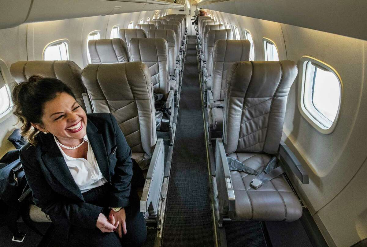 A flight attendant is all smiles as she waits for passengers for the return flight of the inaugural flight of the OneJet service between Albany and Buffalo arrives this morning Tuesday Feb. 13, 2018 at the Albany International Airport in Albany, N.Y. (Skip Dickstein/Times Union)