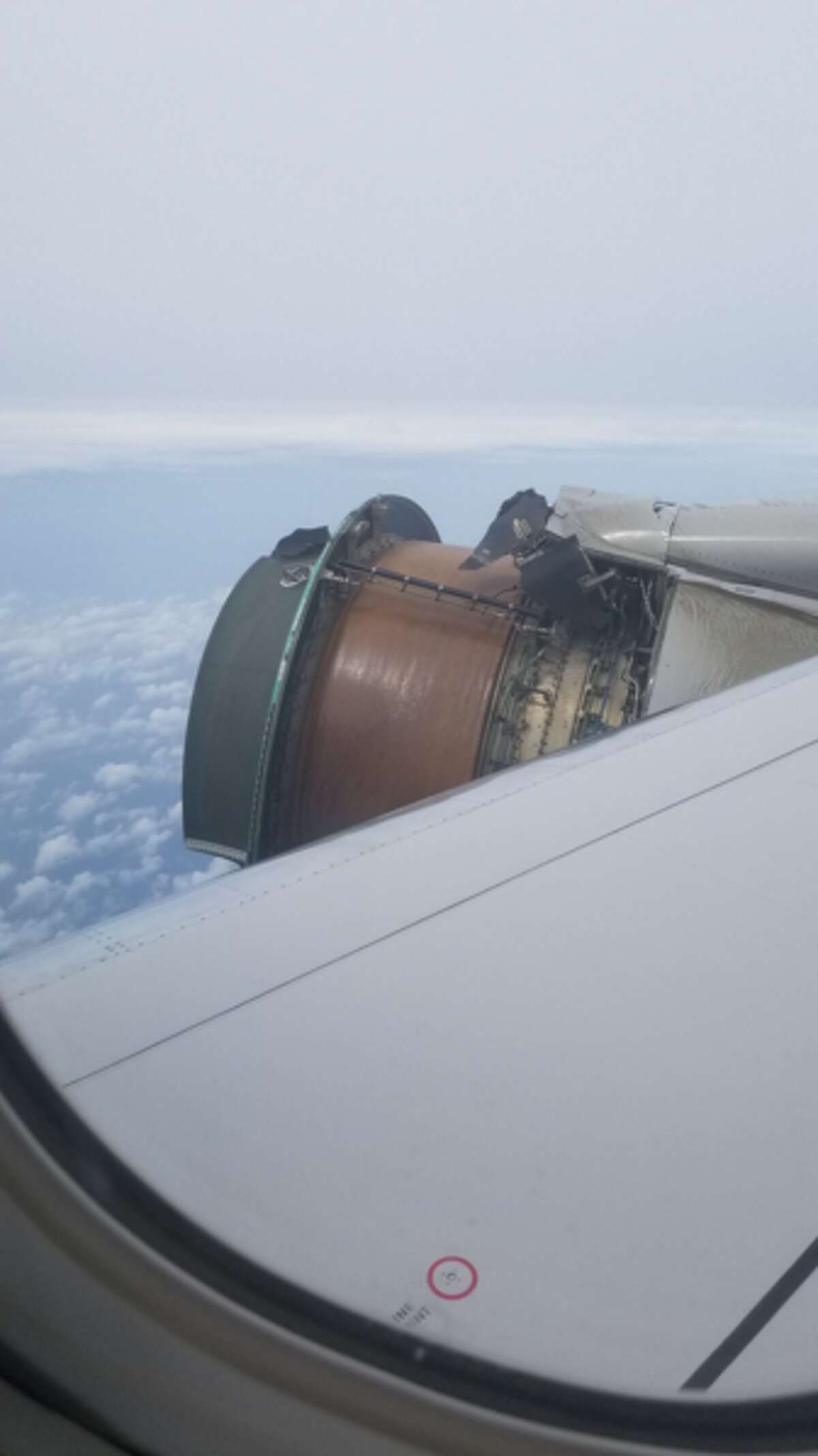 Passenger Maria Falaschi took these photos of an exposed starboard-side engine aboard United Airlines flight 1175 from San Francisco to Honolulu on Tuesday, Feb. 13.