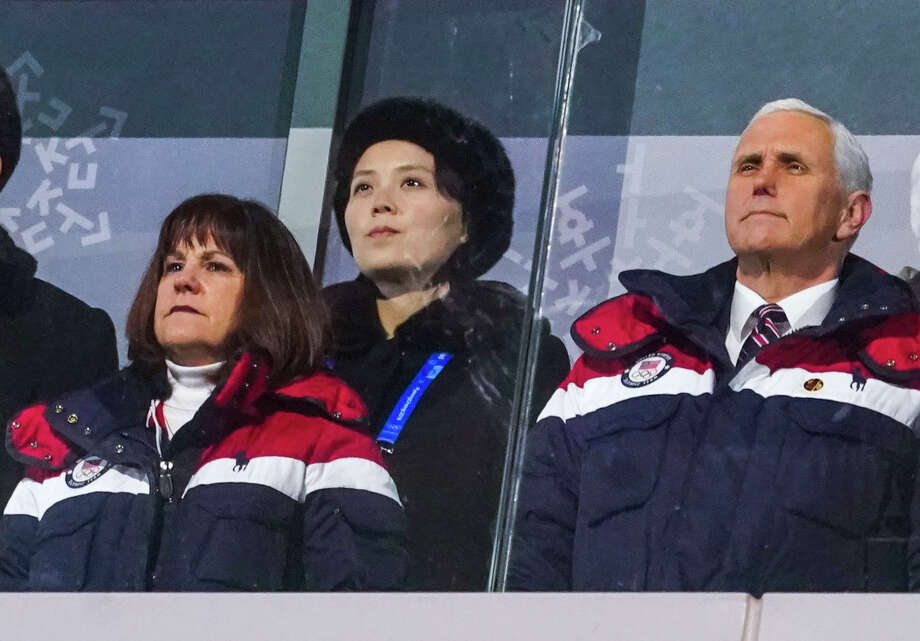 Vice President Mike Pence and his wife, Karen Pence, stand with Kim Yo-jong, sister of North Korean leader Kim Jong-un, during the opening ceremony of the 2018 Winter Olympics in Pyeongchang, South Korea, on Friday, Feb. 9, 2018. Flashing a and without ever speaking in public, Kim managed to outflank Pence, President Donald Trump's envoy to the Olympics, in the game of diplomatic image-making during their time in the country. (Doug Mills/The New York Times) Photo: DOUG MILLS, STF / NYTNS