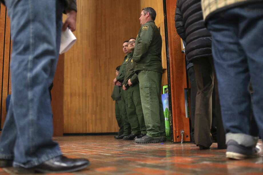 U.S. Border Patrol agents stand outside the Frank Ferree Jury Room in the Cameron County Courthouse as jury selection begins in the capital murder trial of Mexican national Gustavo Tijerina-Sandoval in Brownsville, Texas, Tuesday, Feb. 13, 2018. Tijerina-Sandoval is accused of killing U.S. Border Patrol agent Javier Vega, Jr. in August of 2014. Vega was fishing with his family in Santa Monica, a secluded area near Harlingen, when two men attempted to rob the group. Vega pulled out his weapon and was shot in the chest. He died en route to the hospital. Tijerina-Sandoval and Ismael Hernandez-Vallejo are both charged in Vega's death, but their trials will be held separately. Photo: JERRY LARA / San Antonio Express-News / © 2018 San Antonio Express-News
