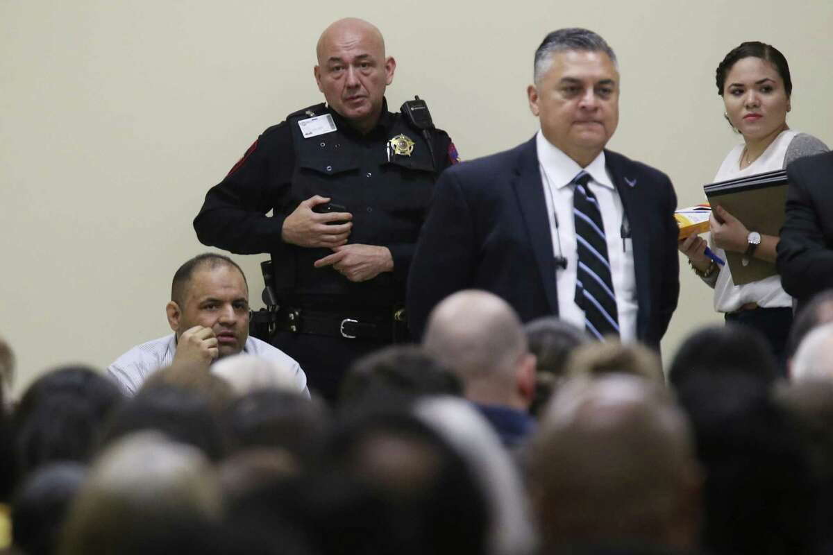 Mexican national Gustavo Tijerina-Sandoval, lower left, sits in front of the jury pool as jury selection begins in his capital murder trial in the Cameron County 197th District Court in Brownsville, Texas, Tuesday, Feb. 13, 2018. Tijerina-Sandoval is accused of killing U.S. Border Patrol agent Javier Vega, Jr. in August of 2014. Vega was fishing with his family in Santa Monica, a secluded area near Harlingen, when two men attempted to rob the group. Vega pulled out his weapon and was shot in the chest. He died en route to the hospital. Tijerina-Sandoval and Ismael Hernandez-Vallejo are both charged in Vega's death, but their trials will be held separately. One of his attorneys Nat Perez, Jr. stand next to him, second from right.