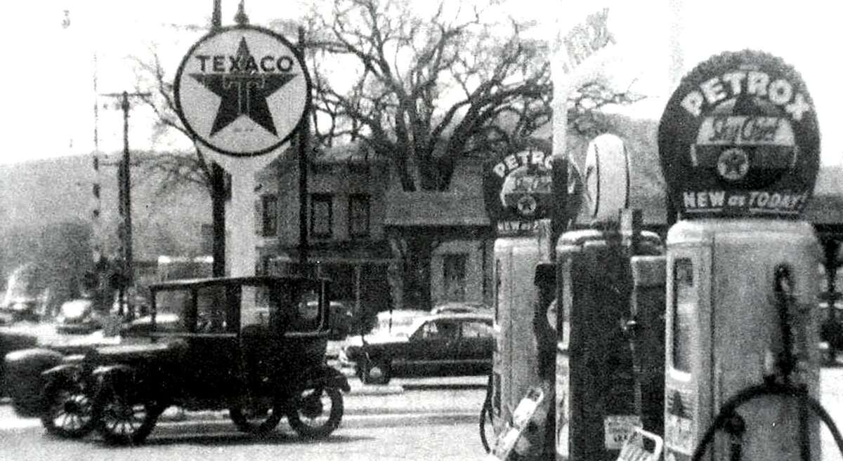 """The face of downtown New Milford has evolved over the years. Back in the day, the corner of Bridge and Main streets was home to Cuddy's gas station, as shown along Bridge Street in this circa 1950s photograph. The station sold Texaco gasoline. Note the1919 Model-T Ford in the parking lot. Veterans Memorial Bridge is in the left background. If you have a """"Way Back When"""" photograph you'd like to share, contact Deborah Rose at drose@newstimes.com or 860-355-7324."""
