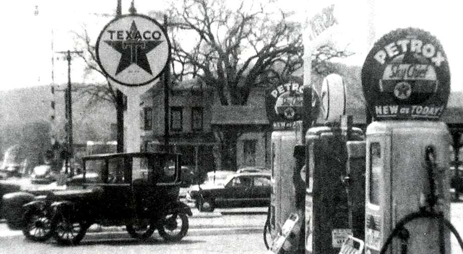 "The face of downtown New Milford has evolved over the years. Back in the day, the corner of Bridge and Main streets was home to Cuddy's gas station, as shown along Bridge Street in this circa 1950s photograph. The station sold Texaco gasoline. Note the1919 Model-T Ford in the parking lot. Veterans Memorial Bridge is in the left background. If you have a ""Way Back When"" photograph you'd like to share, contact Deborah Rose at drose@newstimes.com or 860-355-7324. Photo: Contributed Photo / Contributed Photo / The News-Times Contributed"